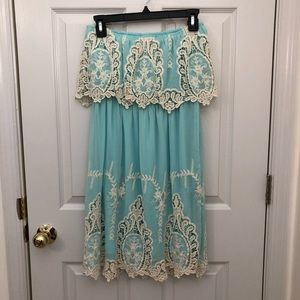 Light blue strapless dress with lace